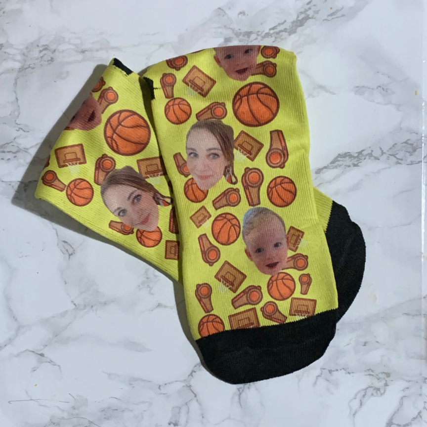 Yellow socks with a picture of my face, Ruben's face and basketballs